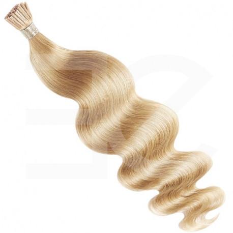 Extensions à froid blondes cheveux bouclés 50 cm