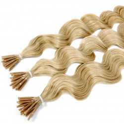 Extensions à froid blond clair cheveux frisés 50 cm